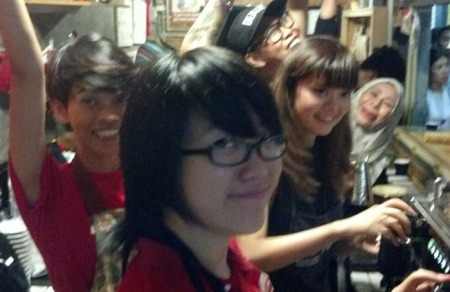 Cecile - The Barista With Attitude! - happily supervises Stef and Sonia who were interning in our pop-up event.